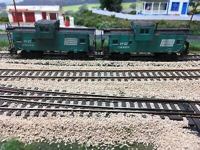 Two HO Scale Penn Central Cabooses