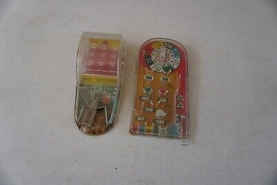 A Pair of Vintage Marx Handheld Pinball Machines Toys