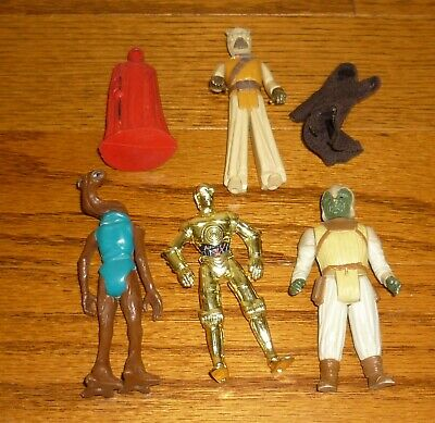Lot of vintage Star Wars action figures and more! used