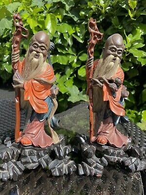 A nice pair of 19th century Chinese lacquer wood Shoulao