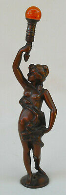 Vintage Art Deco Figurine of Woman Holding an Amber Light