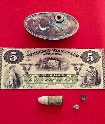 4 relics placed around and on PRINT of a buckle.   Currency is a Copy.