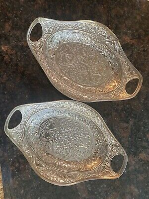 A Pair Of Silver Colored Carved Serving Dishes