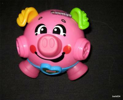 Fisher Price Brilliant Basics Bounce & Giggle Piggy