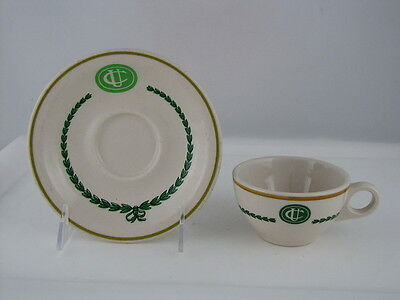 Shenango China Cup & Saucer with UC Logo on a Green Oval