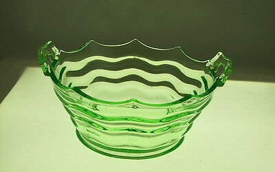"Vaseline Pressed Glass Handled Bowl with Wavy Line Sections, 7 1/2"" dia"