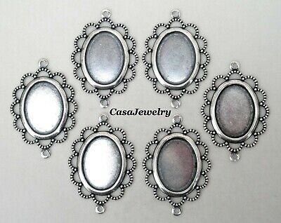 #3056 ANTIQUED SS/P FLAT LACY BORDERED 18x13 BEZEL W/2 HANG RINGS - 6 Pc Lot