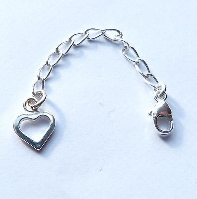 Sterling Silver extension chain with open heart and lobster clasp. Stamped 925