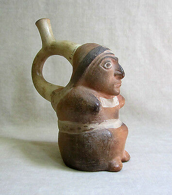 Pre-Columbian MOCHE STIRRUP VESSEL OF A SEATED FIGURE, circa 1 AD - 500 AD