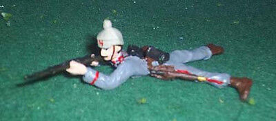 TOY SOLDIERS TIN WWI GERMAN SOLDIER LAYING PRONE FIRING  54MM