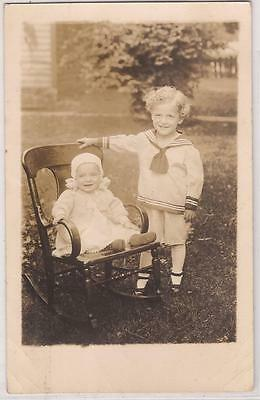 1910s Real Photo Postcard Little Boy Sailor Suit w/ Baby in Rocking Chair Unused