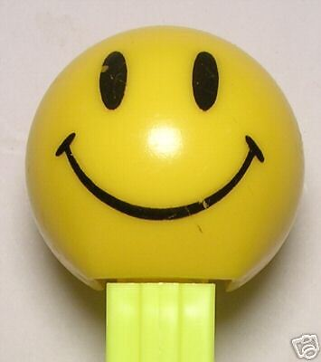 WALMART SMILEY FUNKY FACE PEZ NEON YELLOW STEM LOOSE