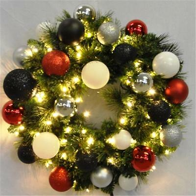 4 ft. Pre-Lit Warm White Sequoia Wreath Decorated with The Modern Ornament Co...