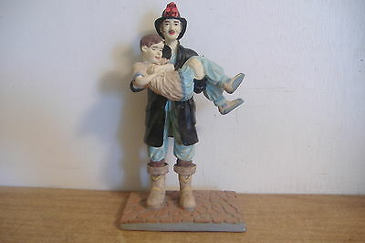 ~Fireman Rescuing A Child~Resin Figurine~1989 Aep Inc.