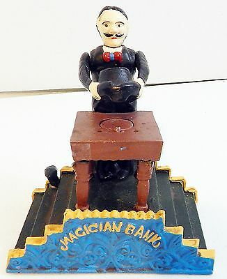 Vintage Cast Iron Mechanical Magician Disappearing Coin Bank - Reproduction