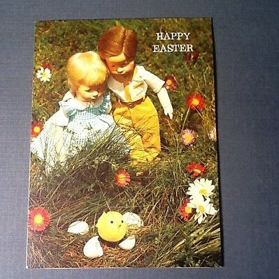 #C977-  Vintage Easter Greeting Card Boy & Girl Doll In Flower Meadow With Chick