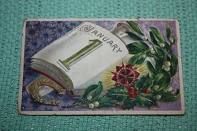 Vintage Postcard January 1 With A Book Horseshoe And Lilly Of The Valley