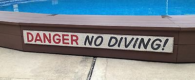 DANGER NO DIVING swimming pool wood bar restaurant sign large beach water