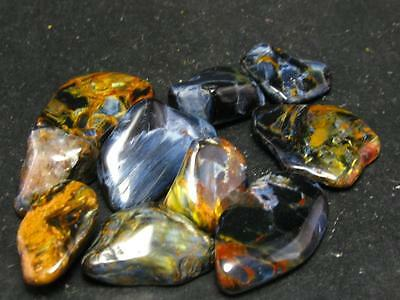 LOT OF 10 BLUE + RED PIETERSITE STONES FROM NAMIBIA