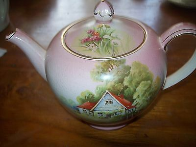 Royal Winton Grimwades Red Roof Teapot - Pink Background