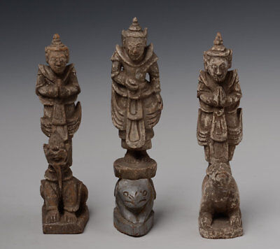 Late 19th Century, A Set of 3 Burmese Wooden Standing Angels on Animals