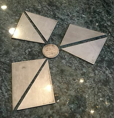 6 small stainless steel non magnetic triangles 2 x 2 1/4 x 0.071 thick material
