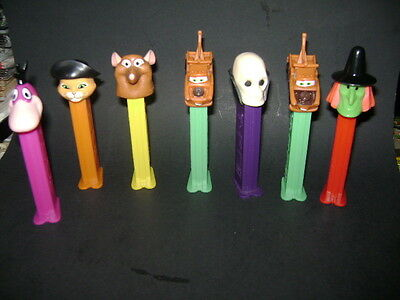 Pez  Lot Of 7  Skull Dino Car Puss N Boots And More