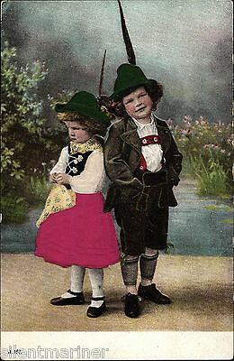 Boy and Girl in Traditional Bavarian Costume, embossed postcard with silk panels