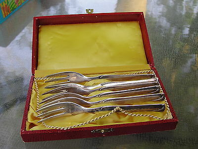 6 Silverplate? Oyster Forks Case Tonks? Marked 100 and two unbrellas on a heart