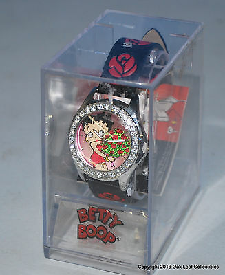 Betty Boop Ladie's Wrist Watch 2002 New never worn Black Band Round shaped face.