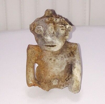 A PRE-COLUMBIAN TERRACOTTA SEATED FIGURE, COLOMBIA, CAUCA RIVER c.800-1100AD