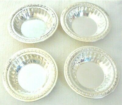 Set of four L Bros Sterling silver nut bowls