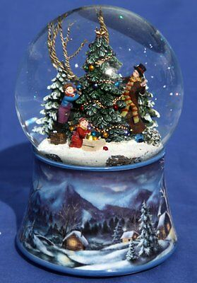 Musical Snow globe with Family decorating the Xmas tree