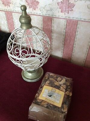 A Cream And Gold Potpourri Holder With A Bag Of French Vanilla Pot Pourri