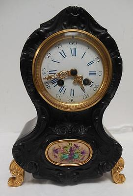 french carved striking  mantle clock c1900s