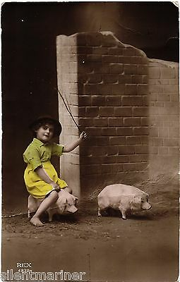 Little Girl Riding Pig, old coloured RP postcard, posted 1915
