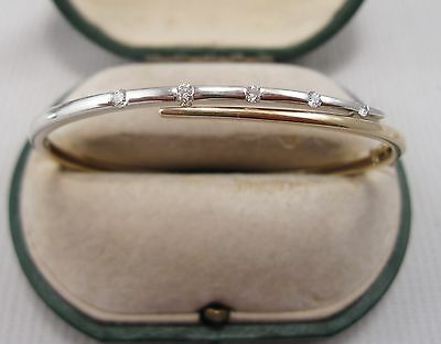 A Fabulous Diamond Bangle in 9ct Yellow & White Gold