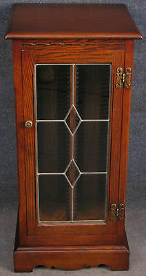 Old Charm Oak Gothic Style Revolving 2 Door CD Storage Cabinet. Tudor Brown