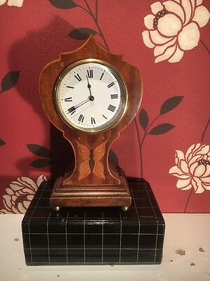 "TULIP CLOCK IN A  MAHOGANY CASE 9 1/2"" HIGH  in good working order."