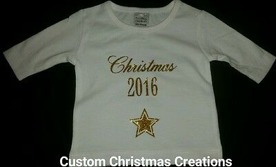 Baby CHRISTMAS 2016 white top w/gold writing NEW boy/girl size 00000