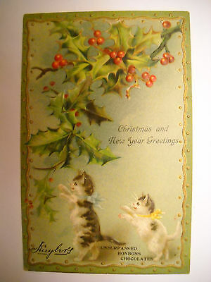 CHRISTMAS NEW YEAR Antique ADVERTISING unused postcard CHROMOLITHO 2 cats play