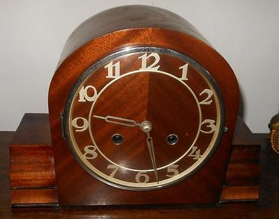 mahogany  cased   striking mantel clock