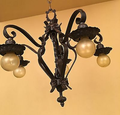 Vintage Lighting 1920s black strap style chandelier