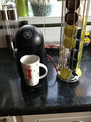 Nescafé Dolce Gusto Coffee Maker And Chrome Pod Holder With Pods