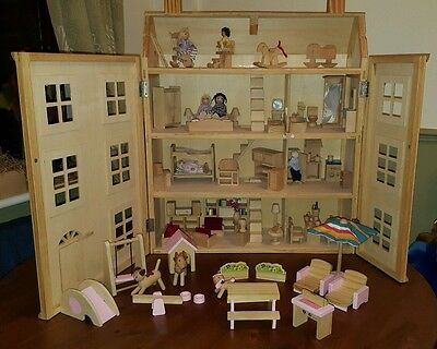 Wooden Dolls House.  With Furniture, People And Animals