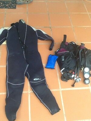 Wetsuit, diving vest and breathing equipment