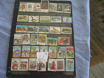 4 PAGES USED AUST. STAMPS. ALL OFF PAPER. Lot 62 NEARLY ALL DIFFERENT.