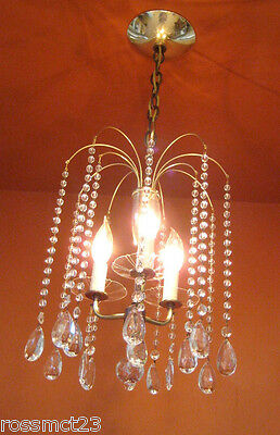 Vintage Lighting 1950s Eames Mid Century Hollywood Regency crystal chandelier