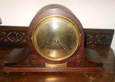 napoleon oak cased striking mantel clock dated 1930
