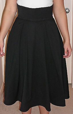 Flared skirt, high waisted. Worsted wool, fully lined. Vintage 1980s from Paris